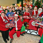 Teign Estuary Rotary Club and Morrisons staff, helping to collect items for Christmas hampers